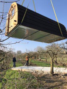 crane-lifting-pods-into-place